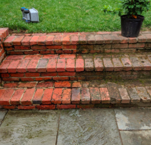 another reviewer's pic of half cleaned outdoor brick stairs
