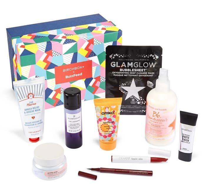 "The beauty samples listed below are arranged in front of a geometric, colorful box labeled ""Birchbox X BuzzFeed."""