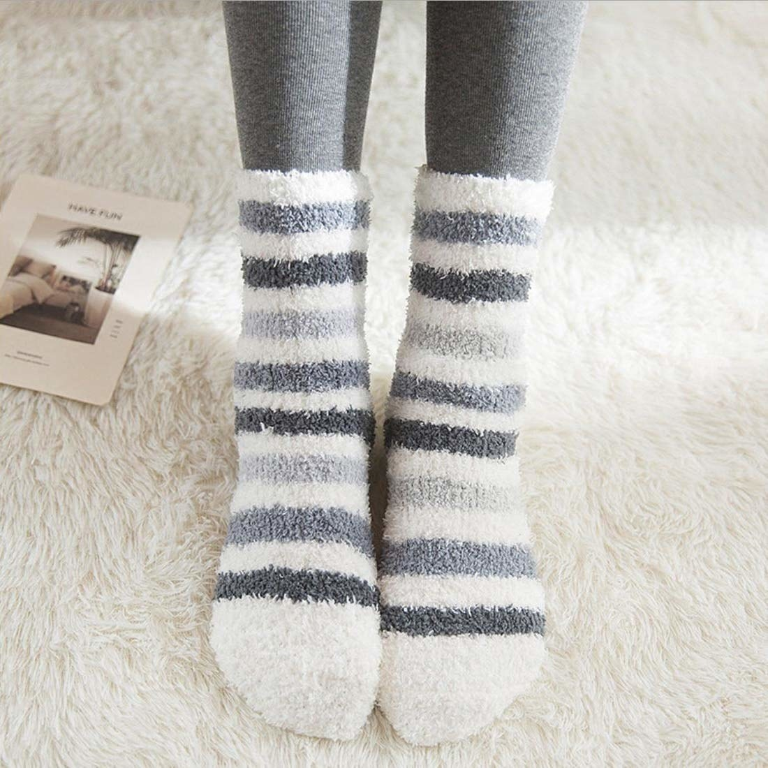 Fuzzy striped socks that hit above ankle