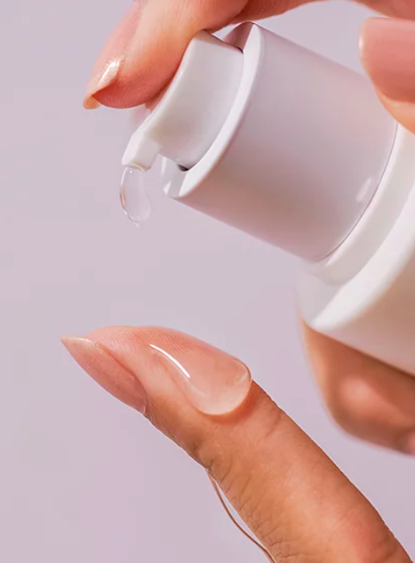 dollop of serum coming out of the nozzle, showing its glass-like, smooth texture
