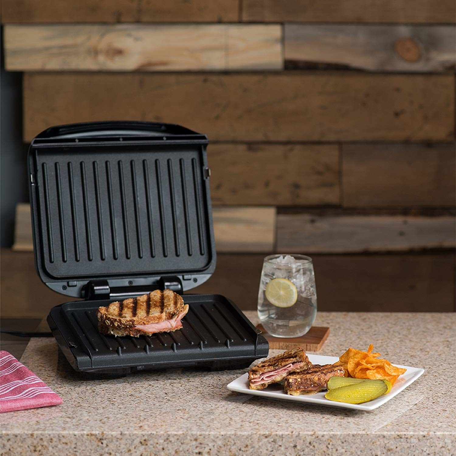 The grill being used to toast a sandwich