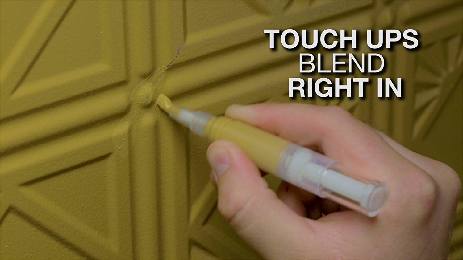 "A hand using the pen to touch up green furniture with text ""touch ups blend right in"""