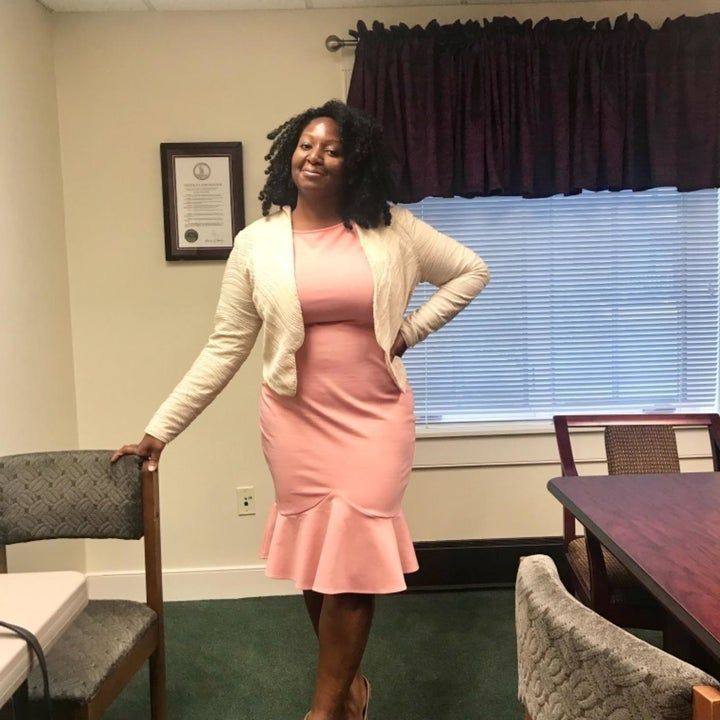 a different reviewer wearing the dress in pink