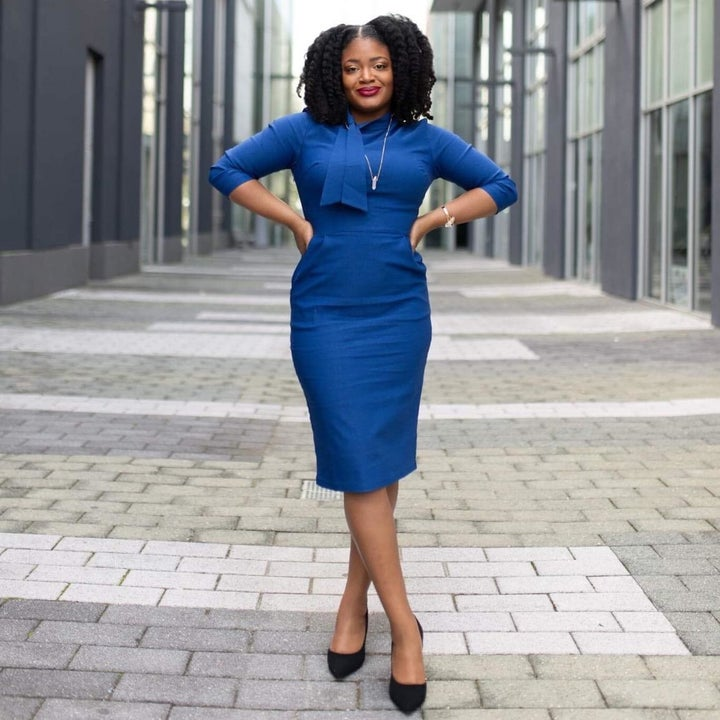Reviewer wearing the dress in blue