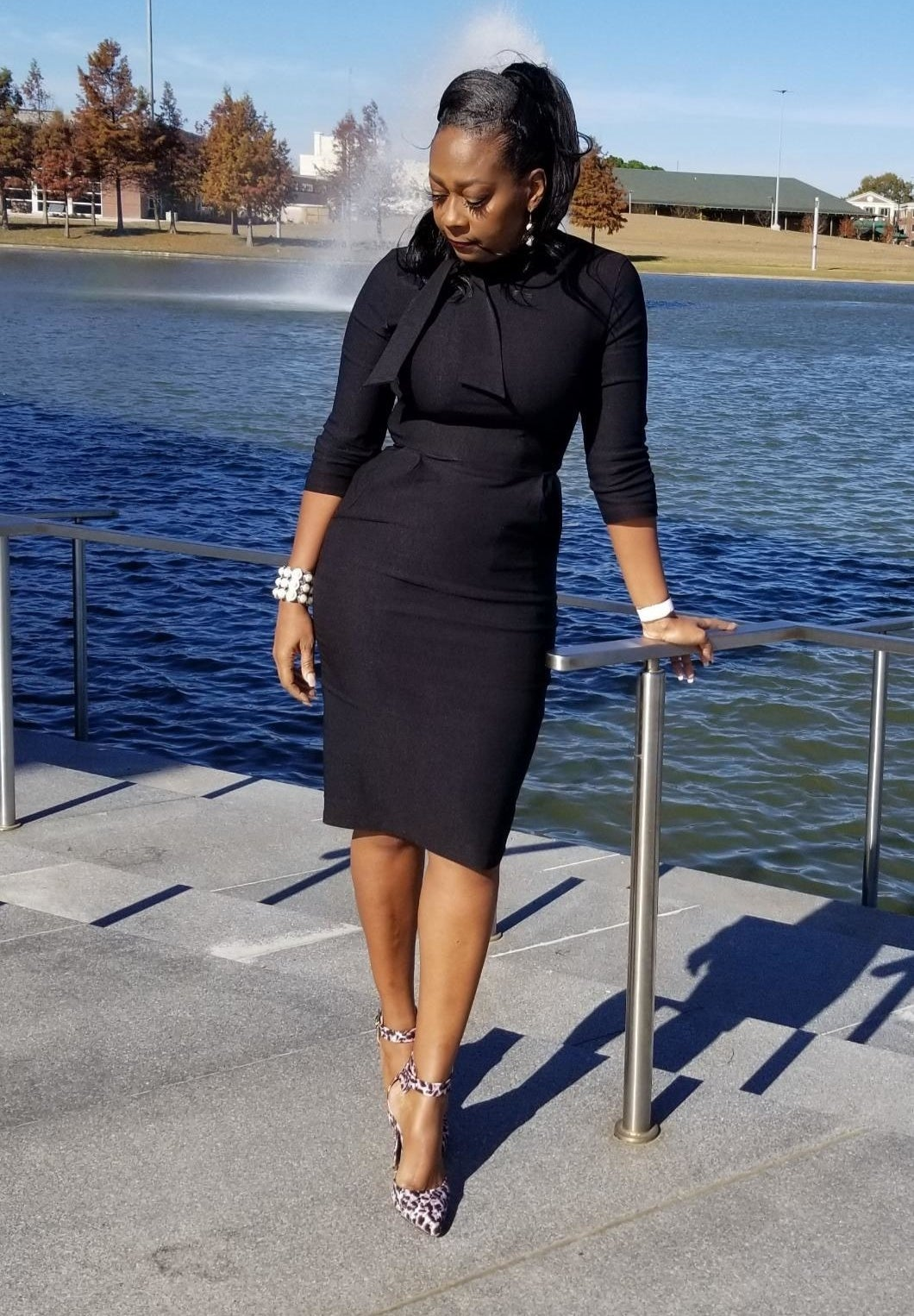 Reviewer wearing the three-quarter sleeve dress in black