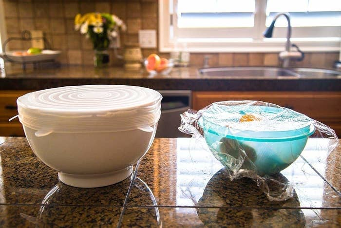 a side by side of two bowls, one with silicone stretch lid covering nicely and one with cling-wrap not doing a great job