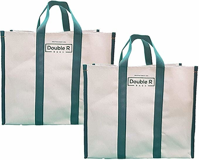 Beige canvas bags with green handles.