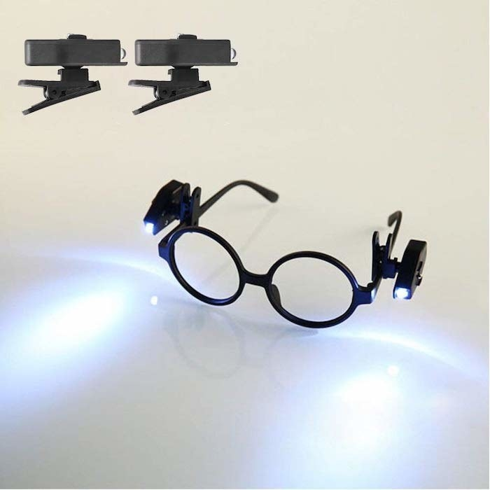 black glasses with one clip on each side