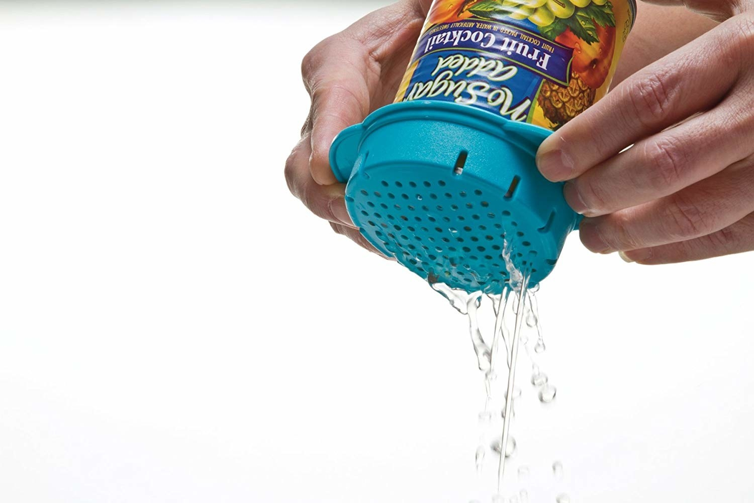 model's hands holding a can with the colander on top of it and pouring broth out of it