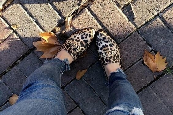 reviewer wearing leopard print loafers