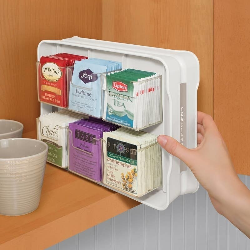 plastic organizer holding tons of tea bags in a small compartments