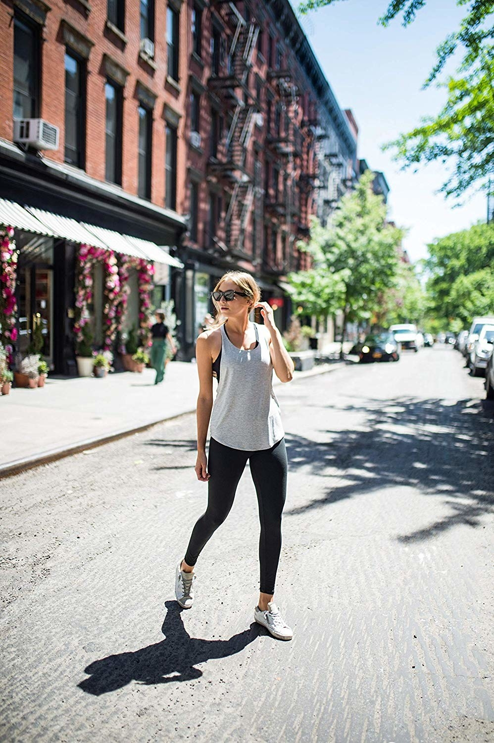 A model wearing the leggings while crossing the street