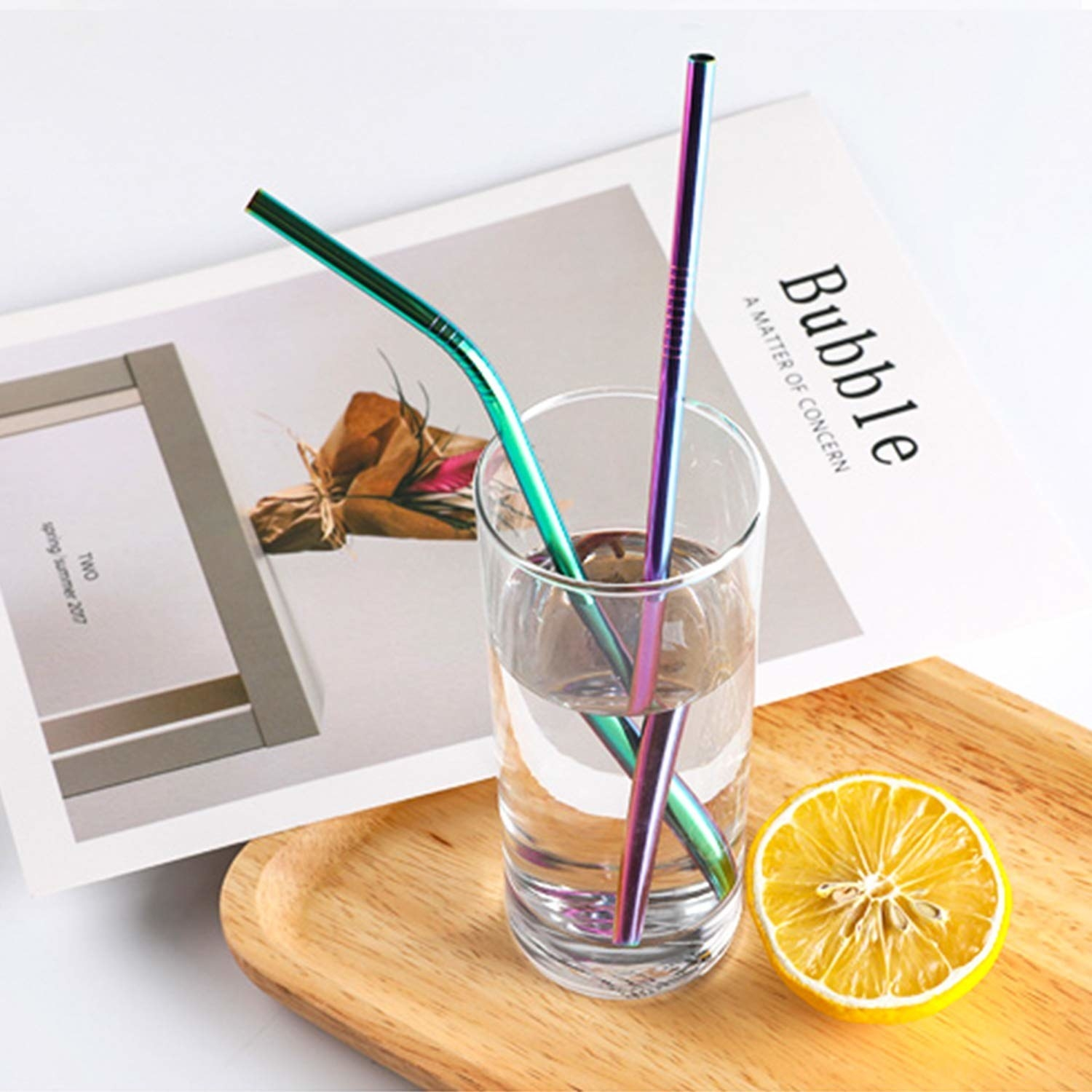 the rainbow metal straws in a glass of water