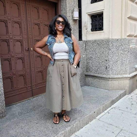 Reviewer wearing the maxi skirt in gray with brown buttons