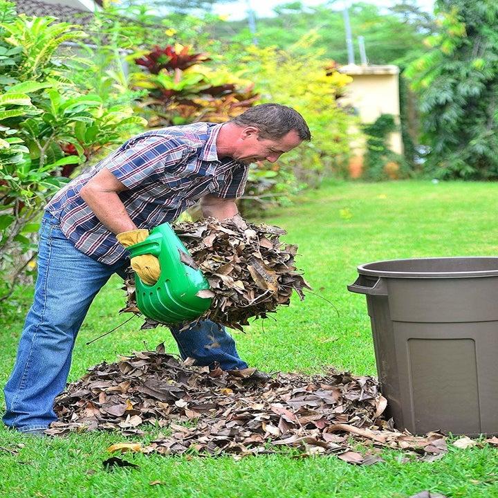 model uses large shovel gloves to move leaves