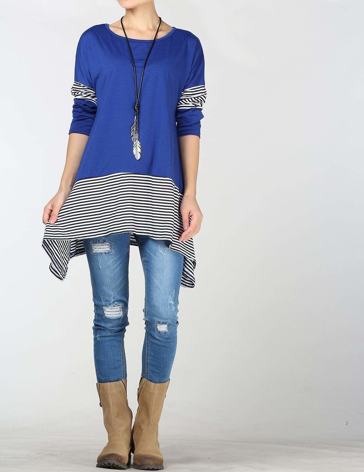 Model wearing the long sleeve top in blue with black and white striped details on hem and sleeves