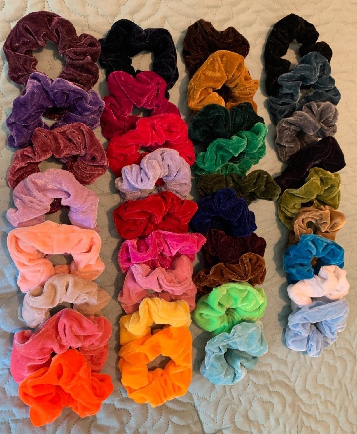 A bunch of scrunchies in various colors.