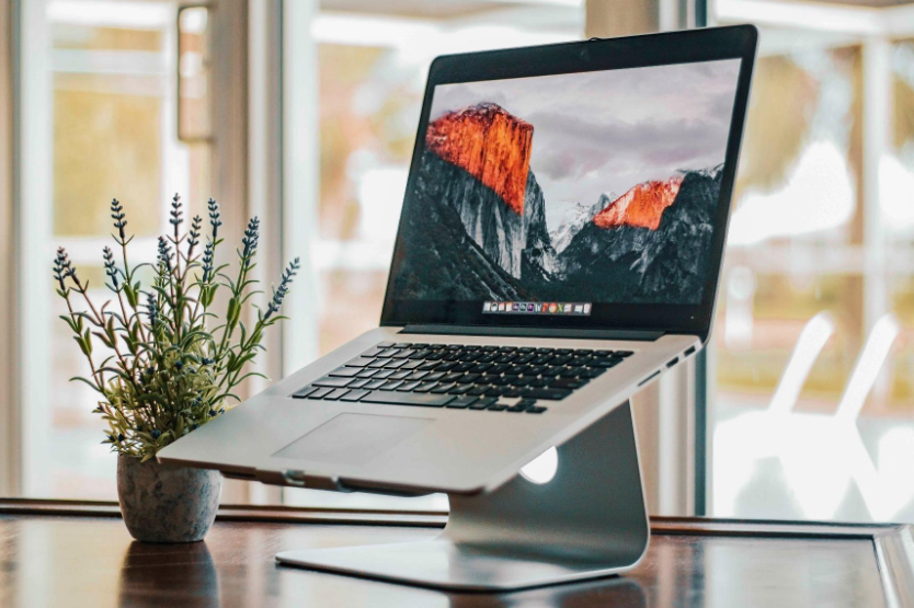 a macbook on the laptop stand