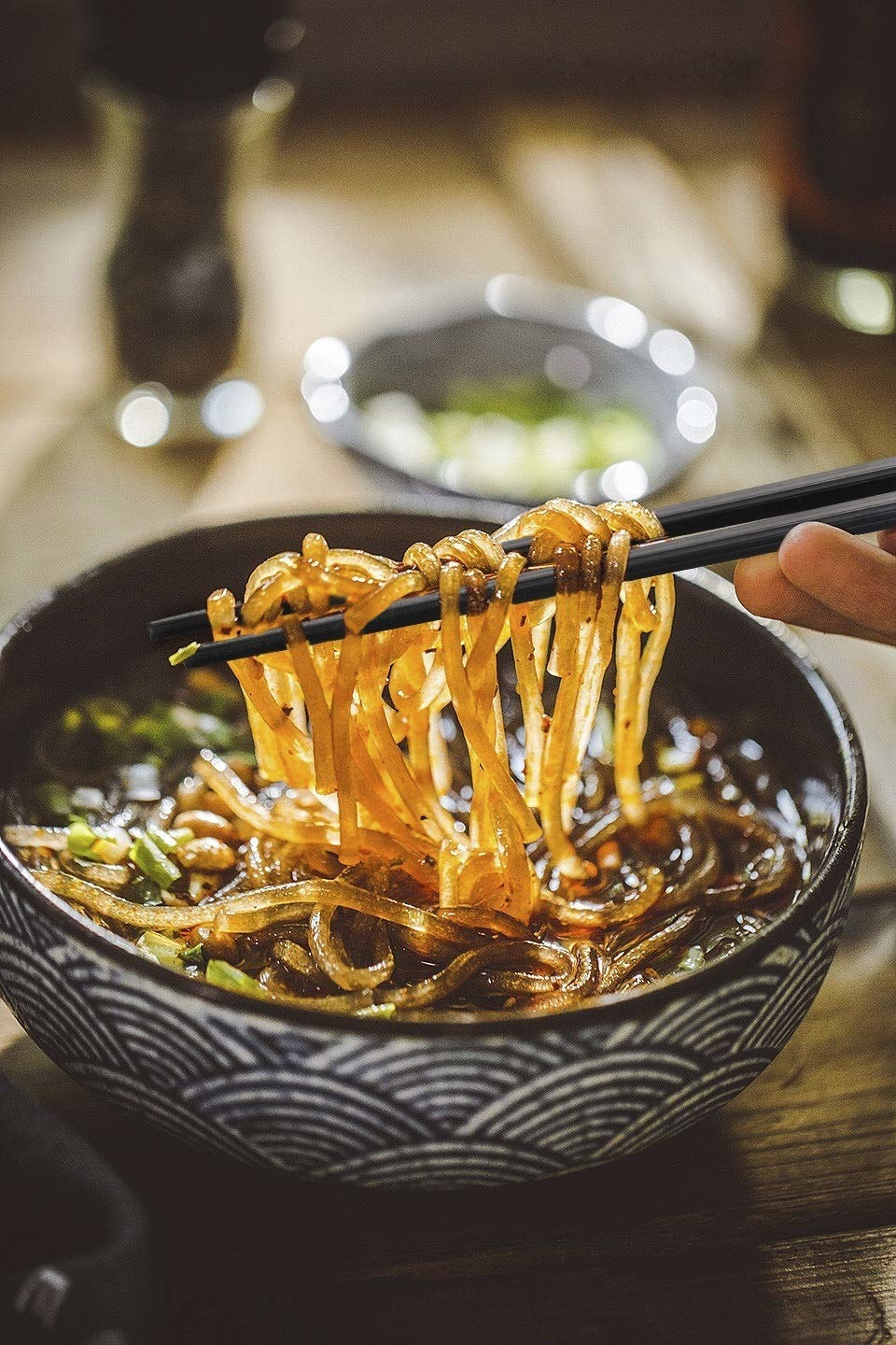 Glass noodles held up with chop sticks