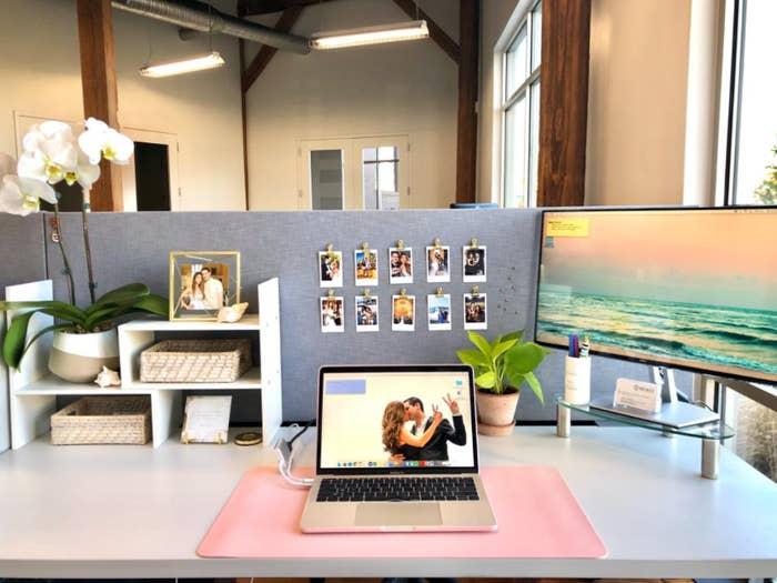 a laptop on the pink anti-slip desk pad