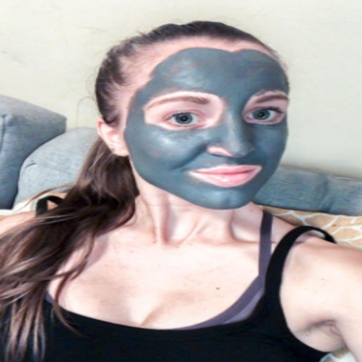 a reviewer wearing the grey face mask all over