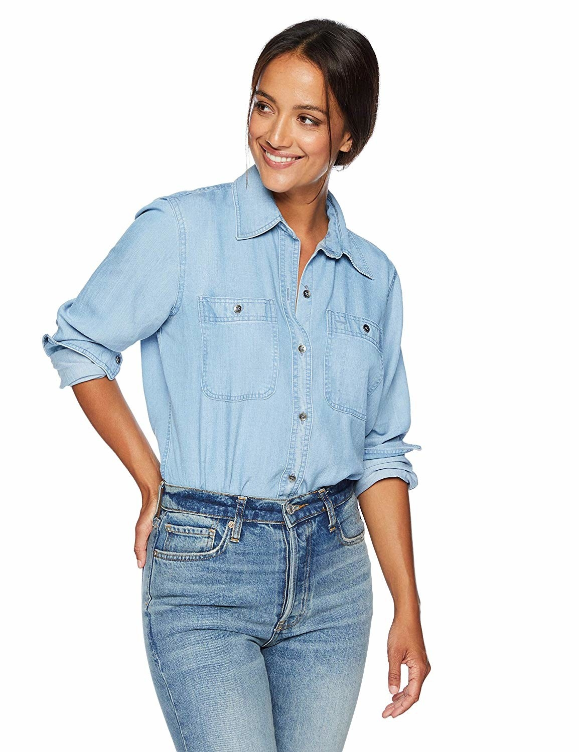 Model in a light wash chambray and jeans