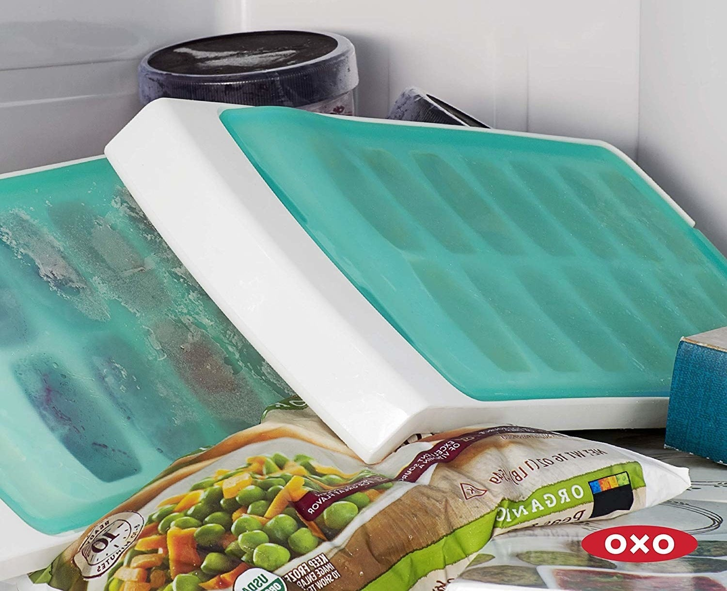 two ice trays with silicone flap covers
