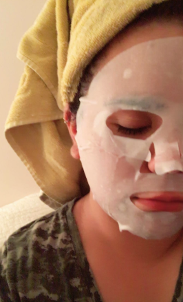 a reviewer wearing the white sheet mask