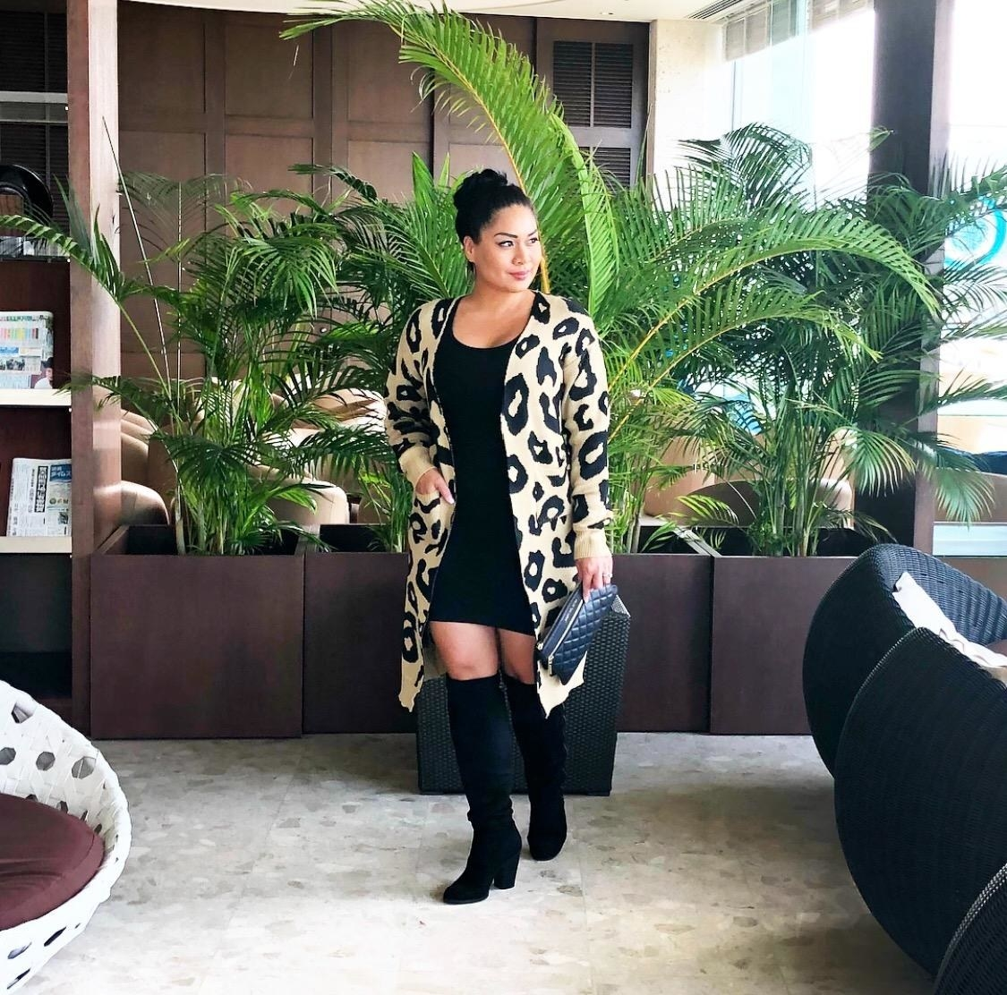 A reviewer in the beige and black large scale leopard print sweater