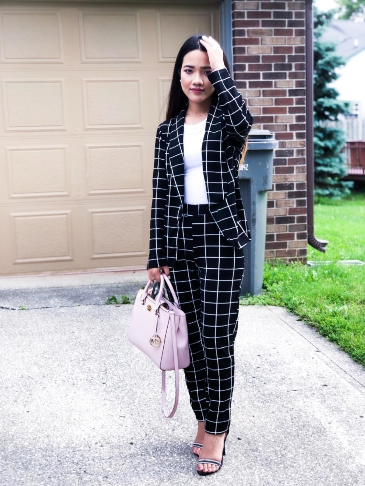 A reviewer in the black suit with white grid pattern