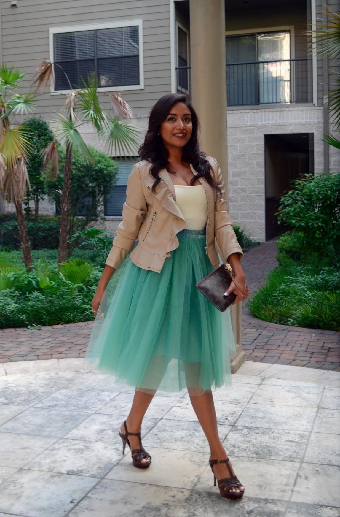 A reviewer in the sea green skirt