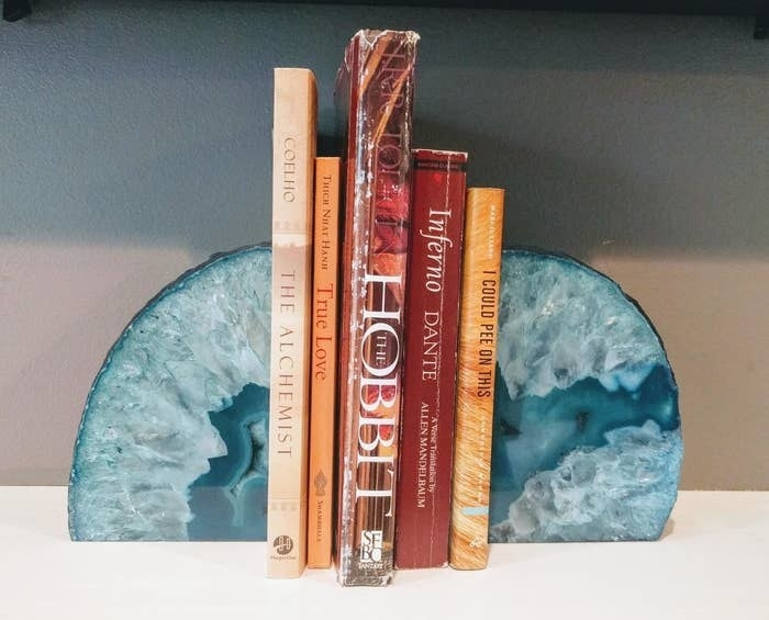 the blue agate bookends holding up five books on a shelf