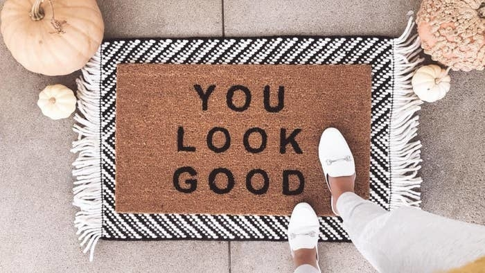 """reviewer's doormat that says """"you look good"""""""