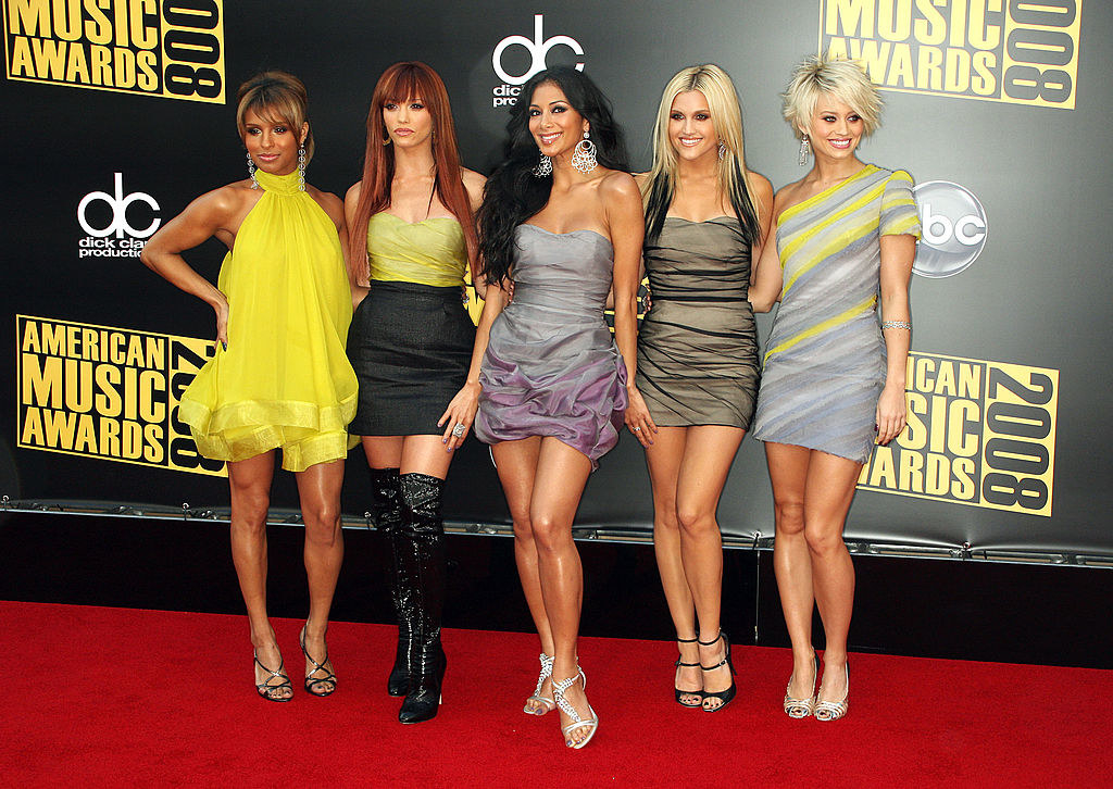 The group posing on the red carpet of the 2008 American Music Awards