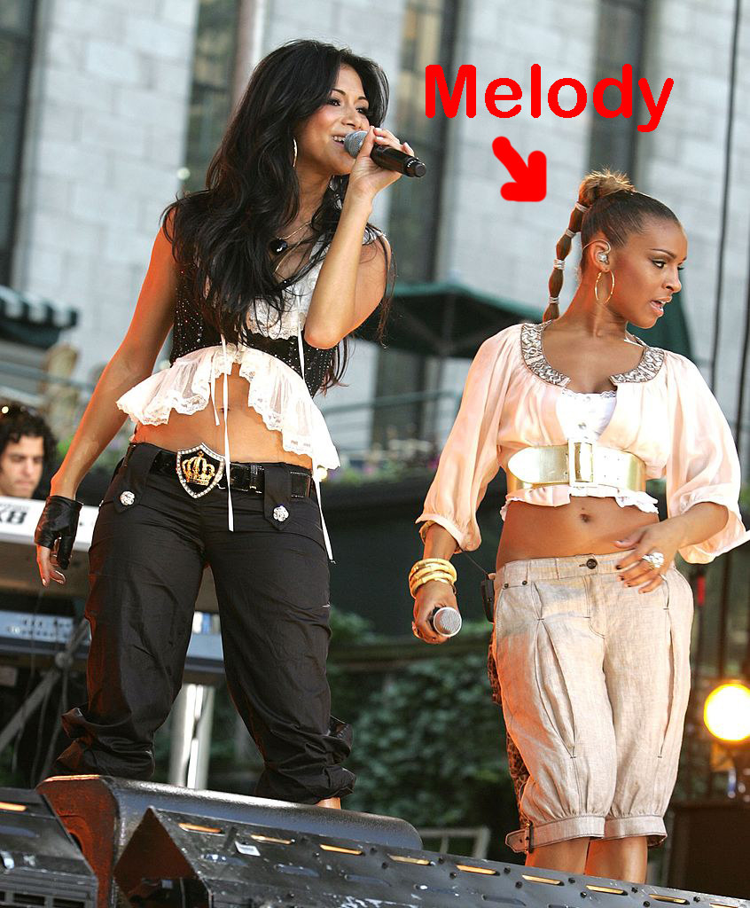 Nicole singing with Melody standing next to her