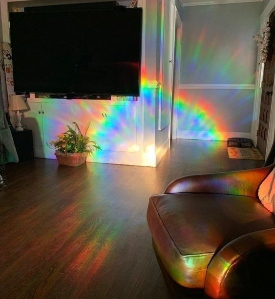 Reviewer's picture of their room cast in rainbow through the film tile