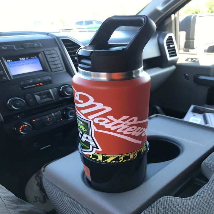 A 36-ounce Yeti bottle sitting in the adapter in a cup holder