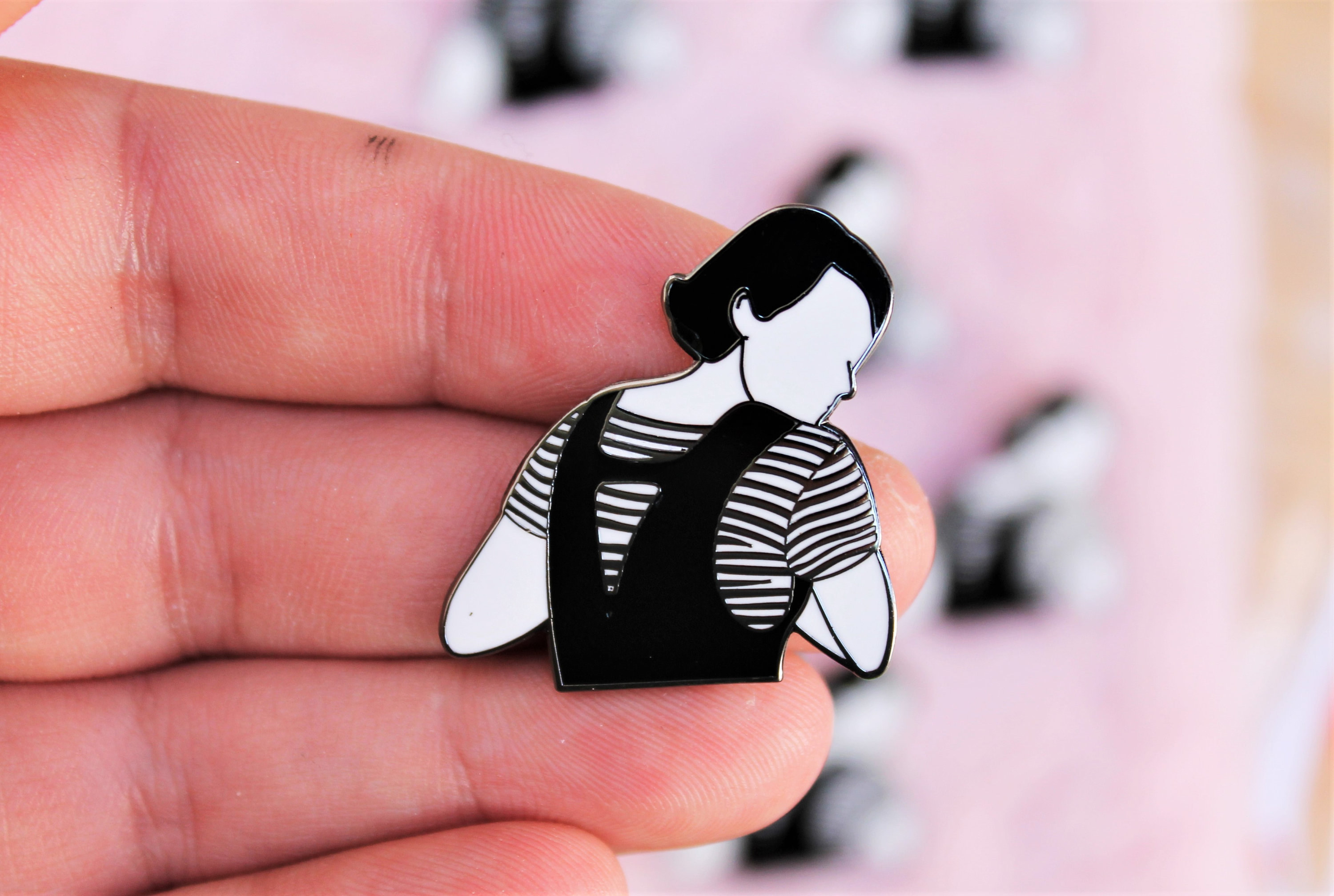 The black and white pin that looks like Fleabag turning looking over her shoulder