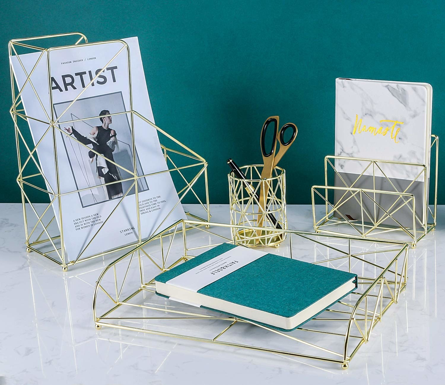 A wiry metal magazine holder, pencil holder, letter tray, and shelf on a desk