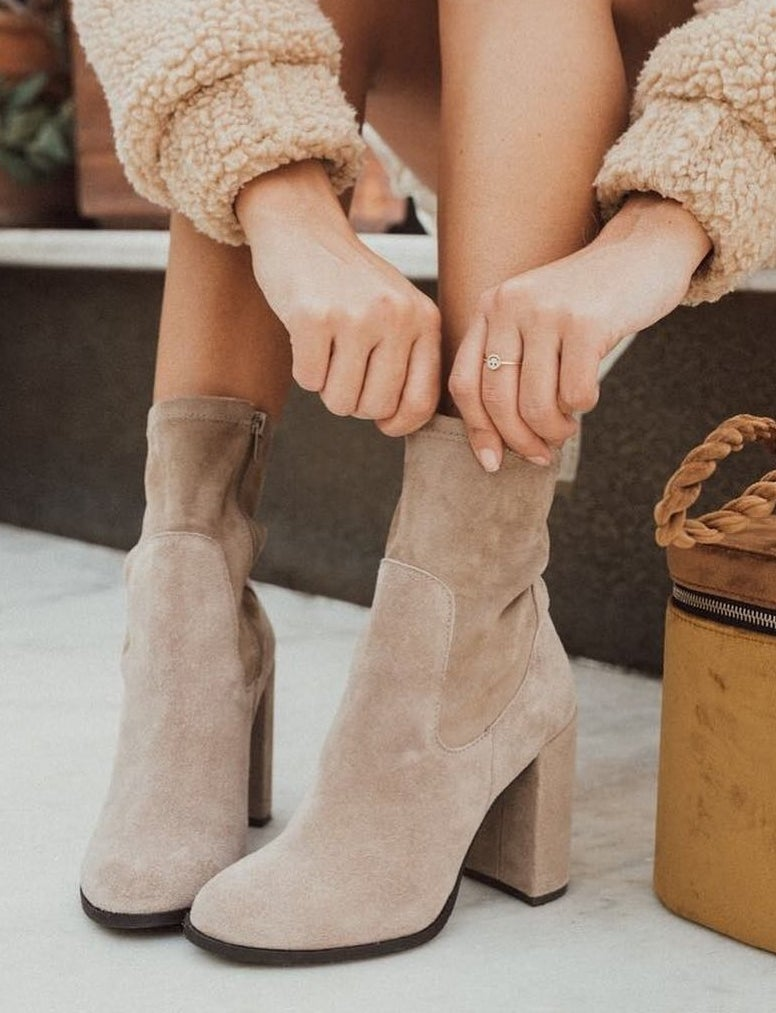 model wearing suede booties
