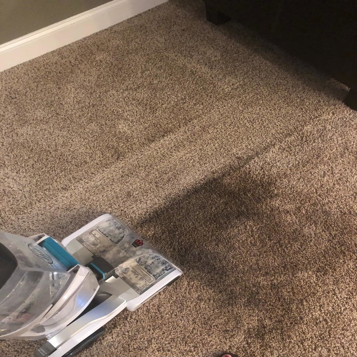 Another reviewer's photo of their carpet half cleaned and you can clearly see the areas where the vacuum has run versus the areas that are still dirty
