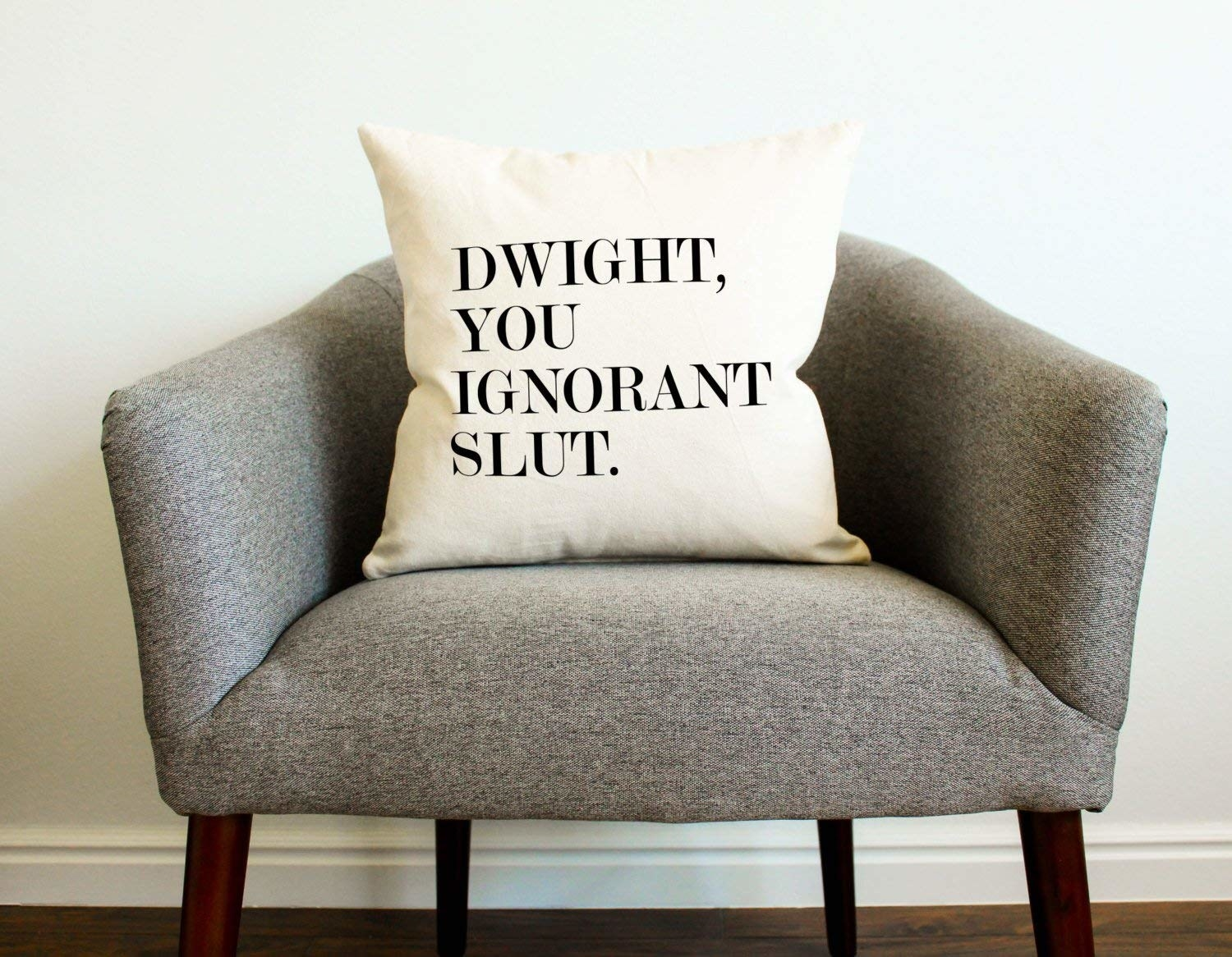 """an off white pillow case with """"dwight you ignorant slut"""" on it"""