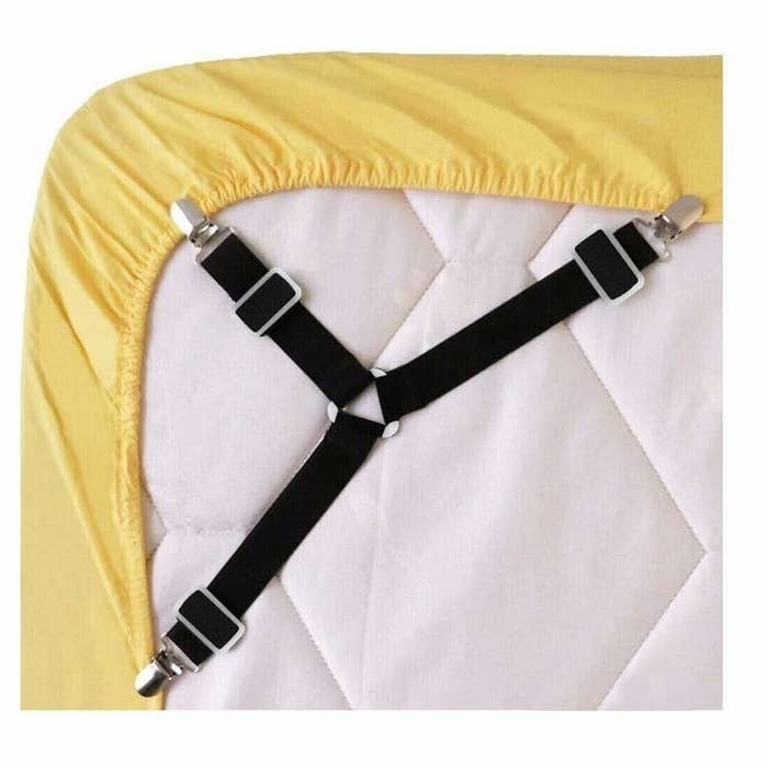 the bedsheet fasteners clipped to a sheet to hold it in place on the underside of a mattress