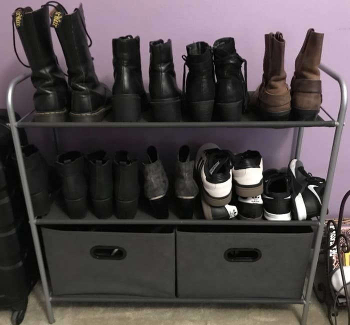 reviewer's organizer holding shoes on two shelves with two bins on the bottom shelf