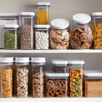 A shelf organized neatly with multiple sizes of the containers