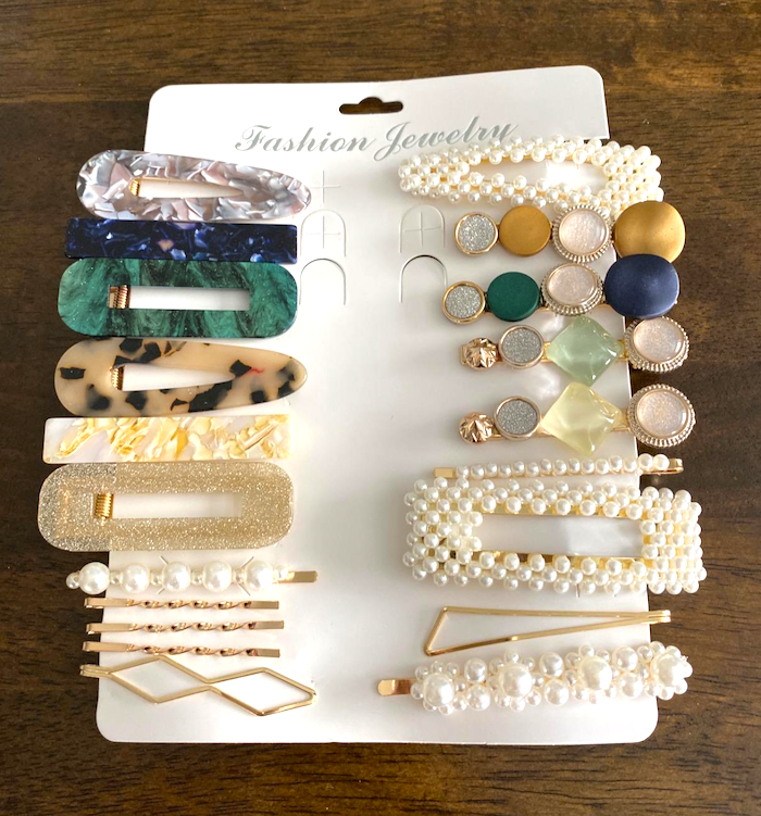 A package of hair clips in all different designs.