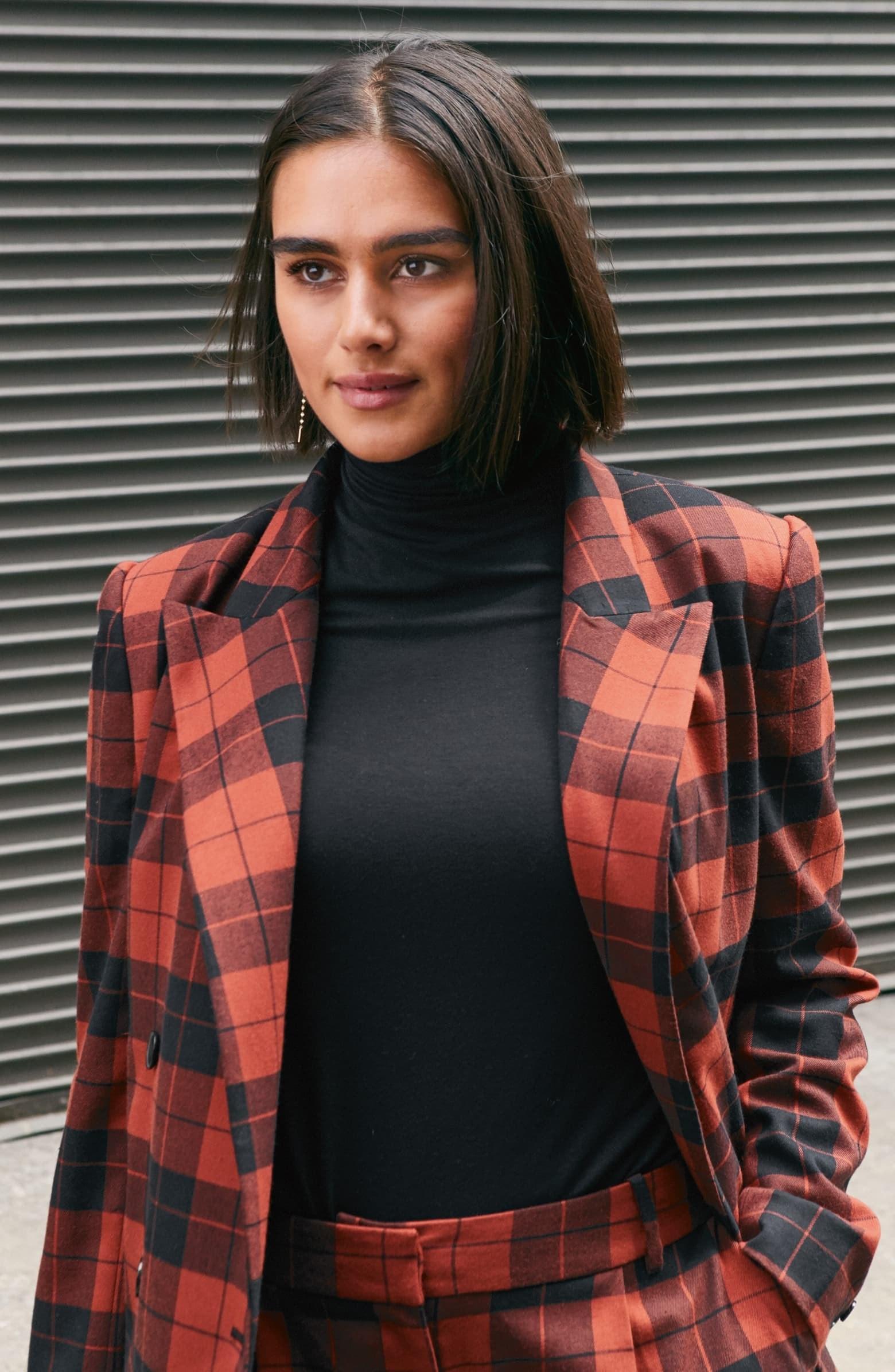 model wearing the thin turtleneck in black