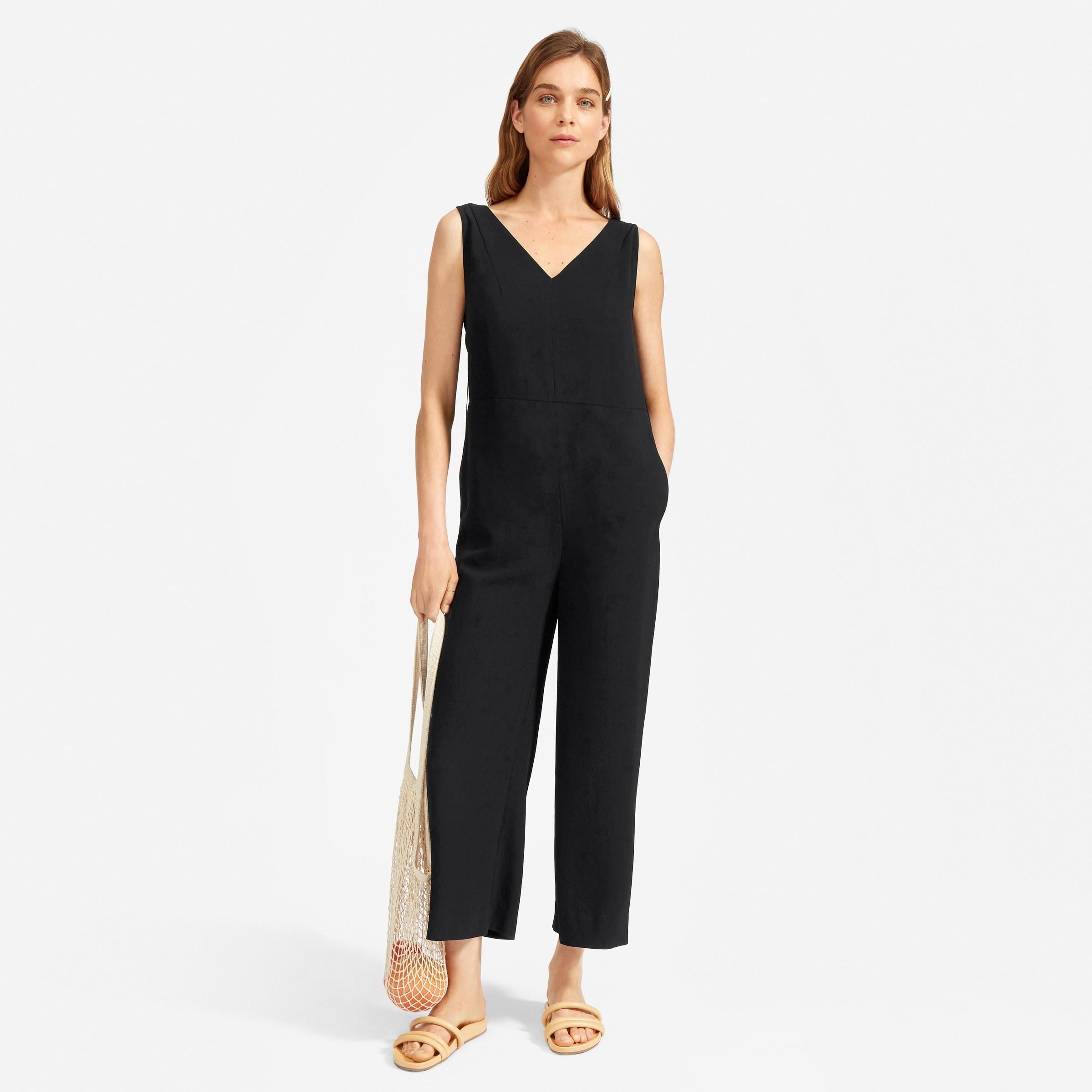 model wearing the v-neck ankle-length jumpsuit in black