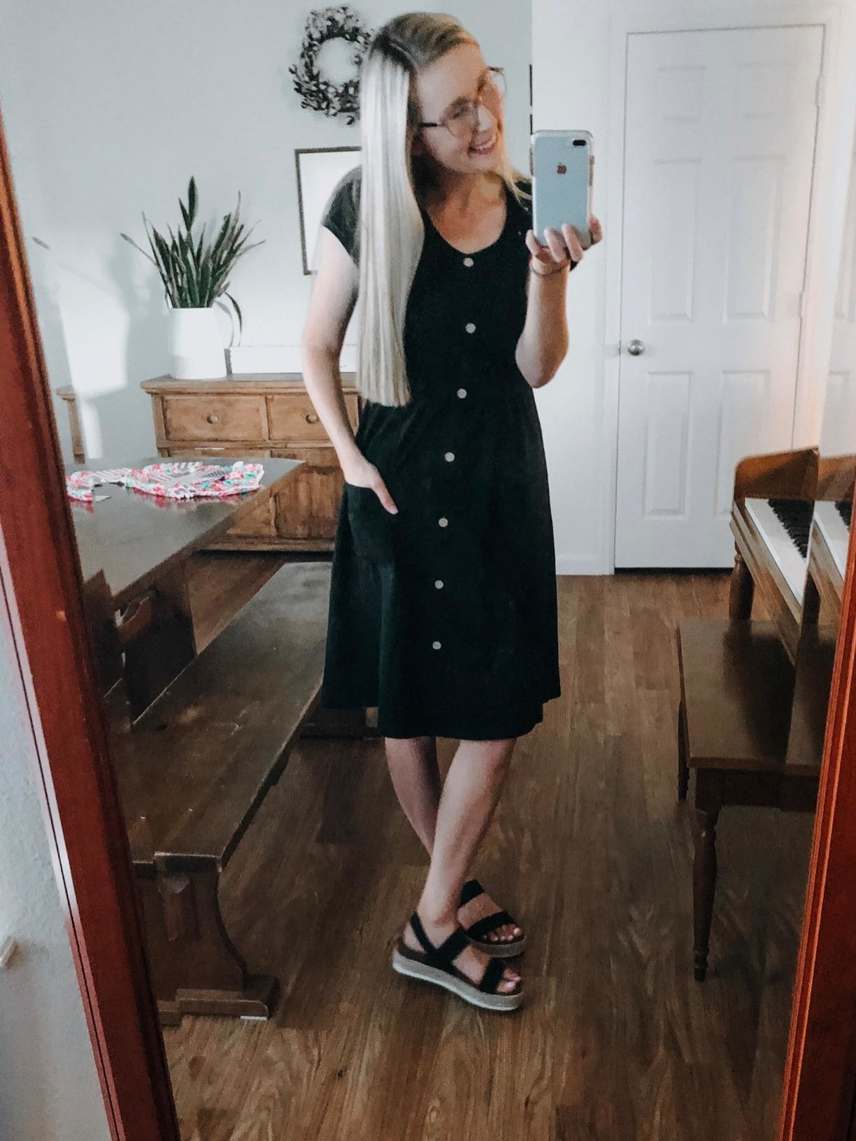 reviewer wears short sleeve midi dress with buttons all the way down