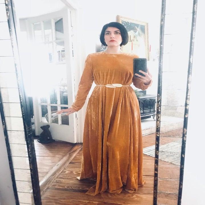 Reviewer wearing the full-length dress in yellow velvet